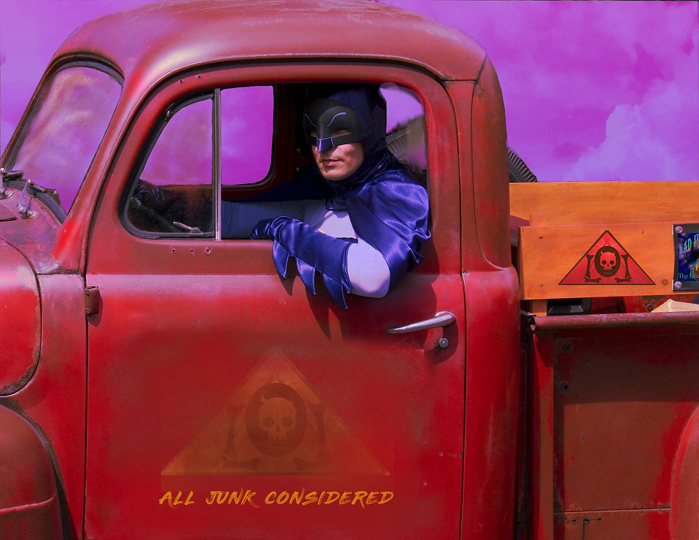 Batman drives Sanford and Sons antique rusted out truck in search of useful junk