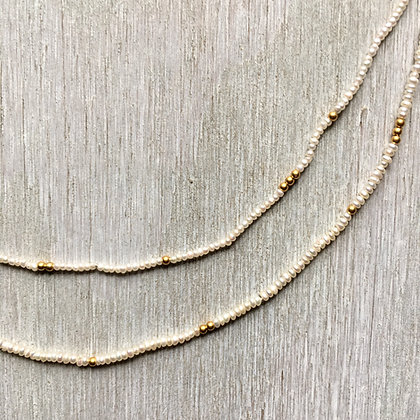 white seed pearl and gold long necklace