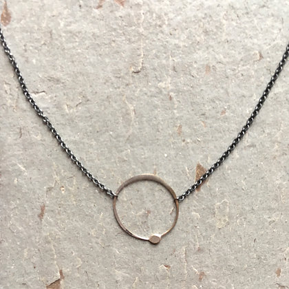 silver circle on black chain