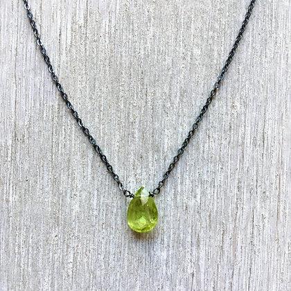peridot on black necklace