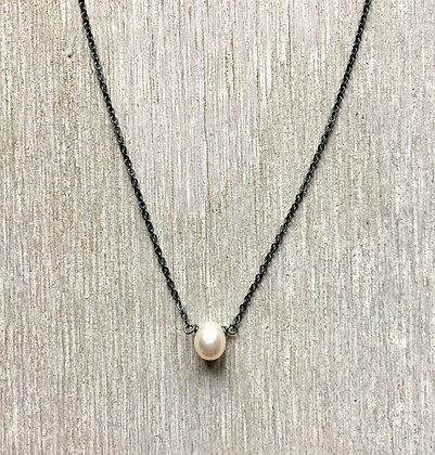 tiny white pearl drop on black sterling