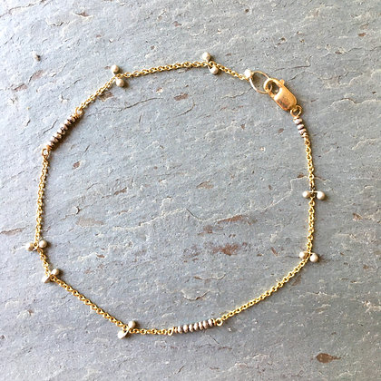 gold chain and silver link bracelet