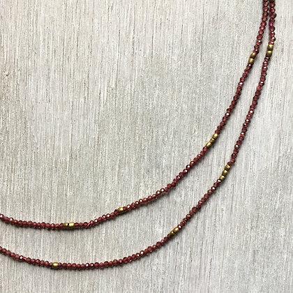 tiny garnet and brass long necklace
