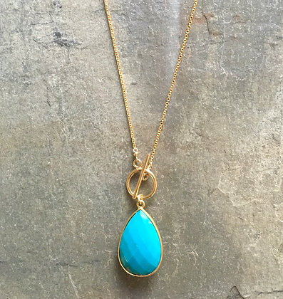 turquoise set in gold on long gold chain