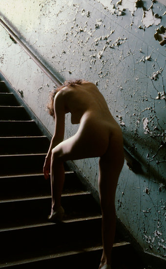 NUDE COLLAPSING ON STAIRWELL