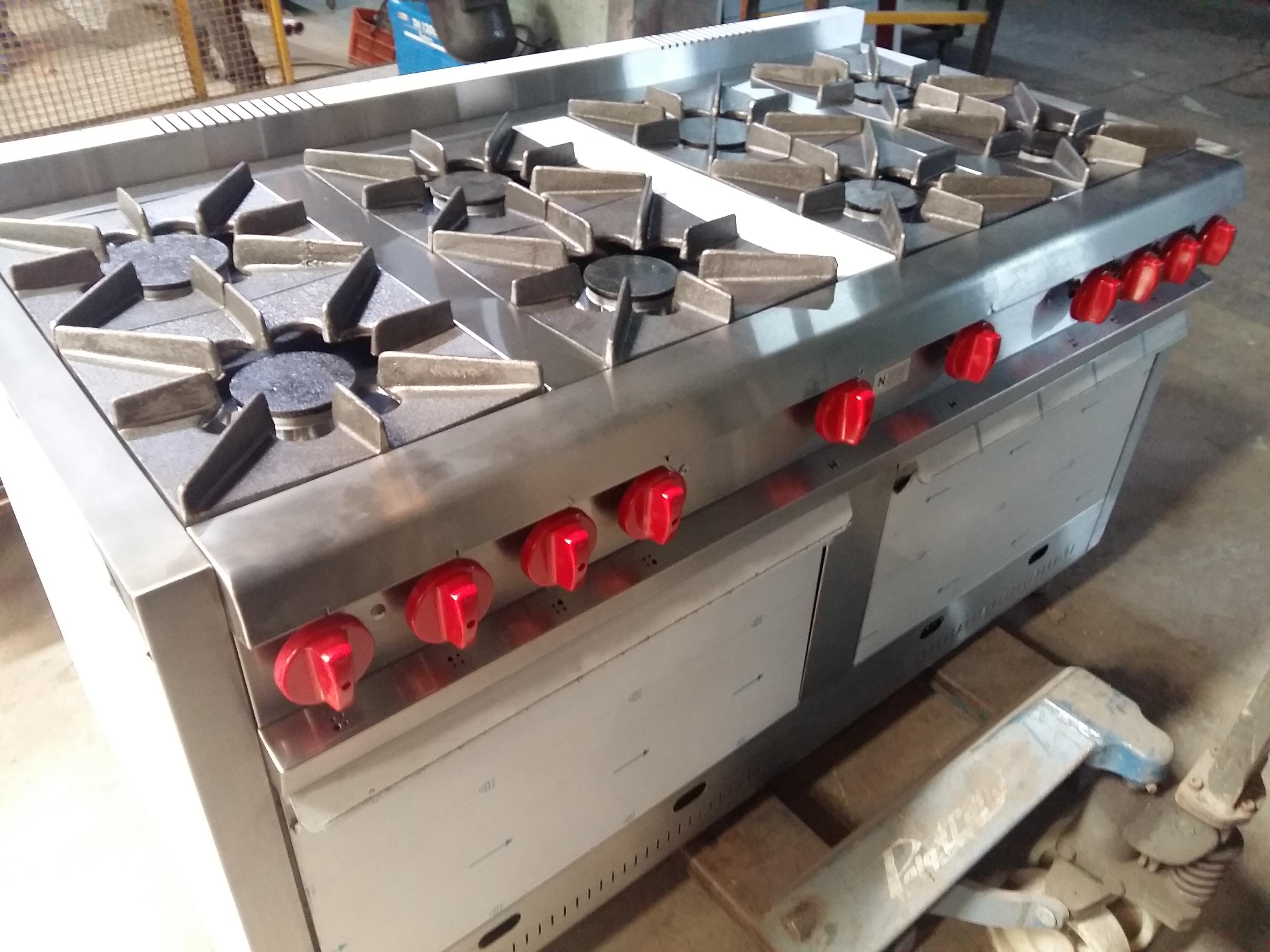Cocina industrial pesada 8 hornallas dos hornos MGA www.fabricainoxidable.com.ar