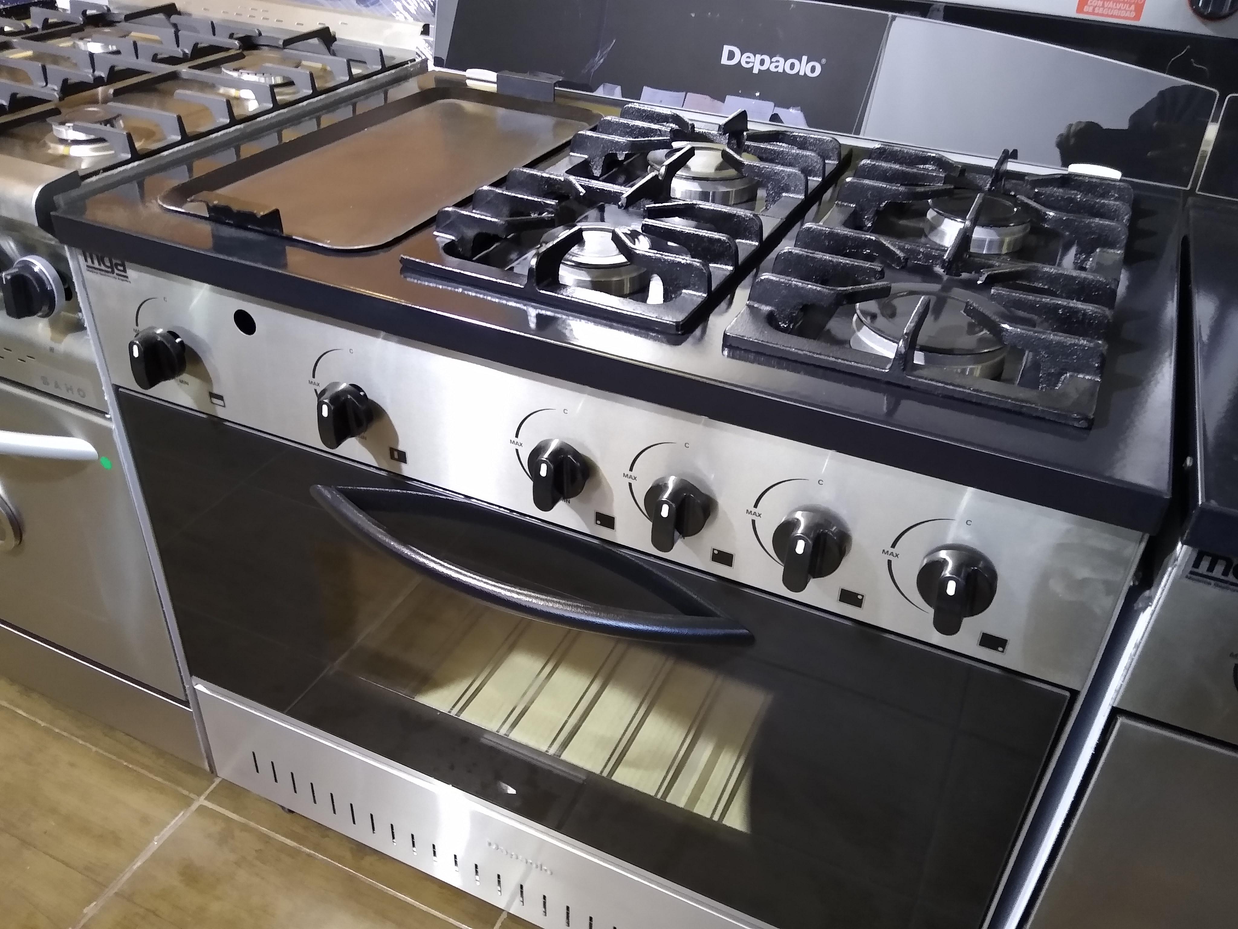 Hornos cocinas anafes campanas estantes y muebles de acero inoxidable FABRICA ITUZAINGO