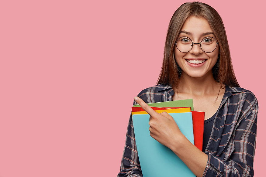 studio-shot-good-looking-young-businesswoman-posing-against-pink-wall-with-glasses_edited.