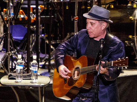 WIND BACK WEDNESDAY CHECKS PAUL SIMON FOR DIAMONDS ON THE SOLES OF HIS SHOES