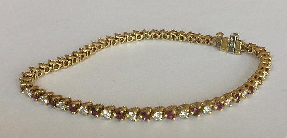 Ruby-diamond tennis bracelet 18K yellow gold