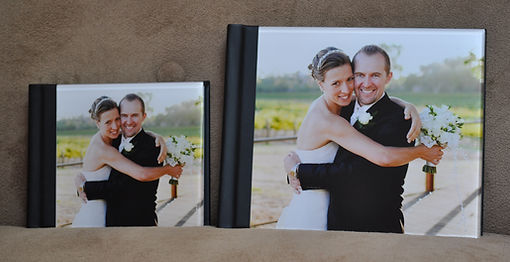 8x10 parent alum next to 11x14 main wedding album