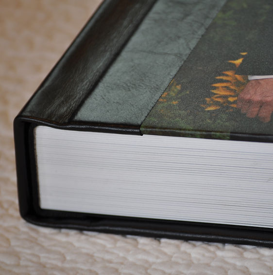 photo-panel wedding album from White Dove Albums, with spine and back in black genuine leather