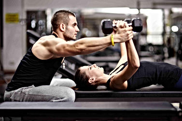 bigstock-Personal-trainer-helping-woman-