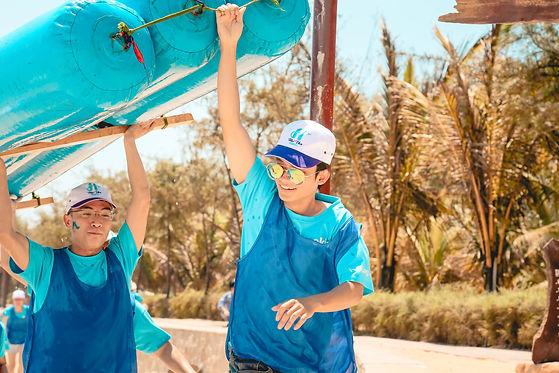 men-in-blue-holding-blue-boat-977241.jpg
