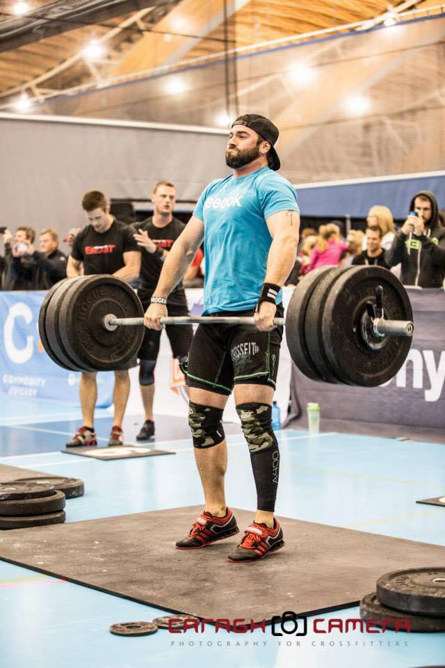 Coach Dub power clean in a crossfit competition