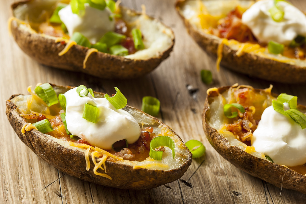Baked Potato skins with sour cream, cheese and chives.