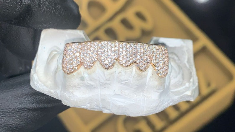 Six full diamond set teeth