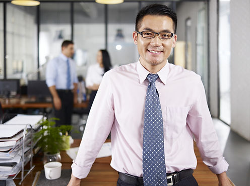 bigstock-Asian-Businessman-Standing-In--