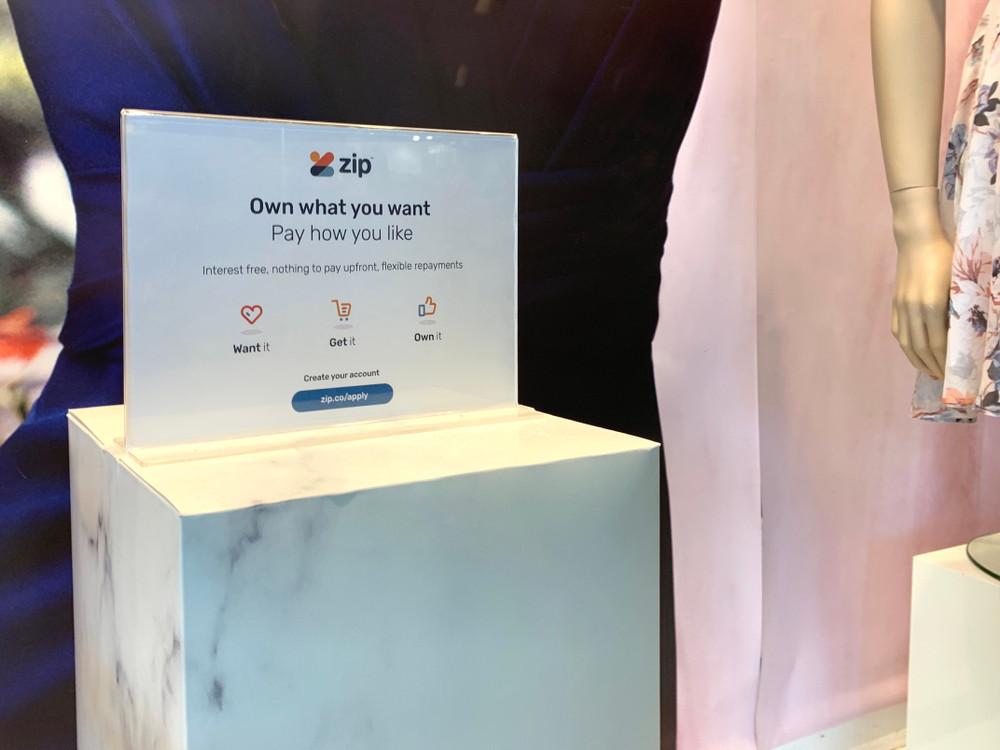 podium displaying zip pay sign