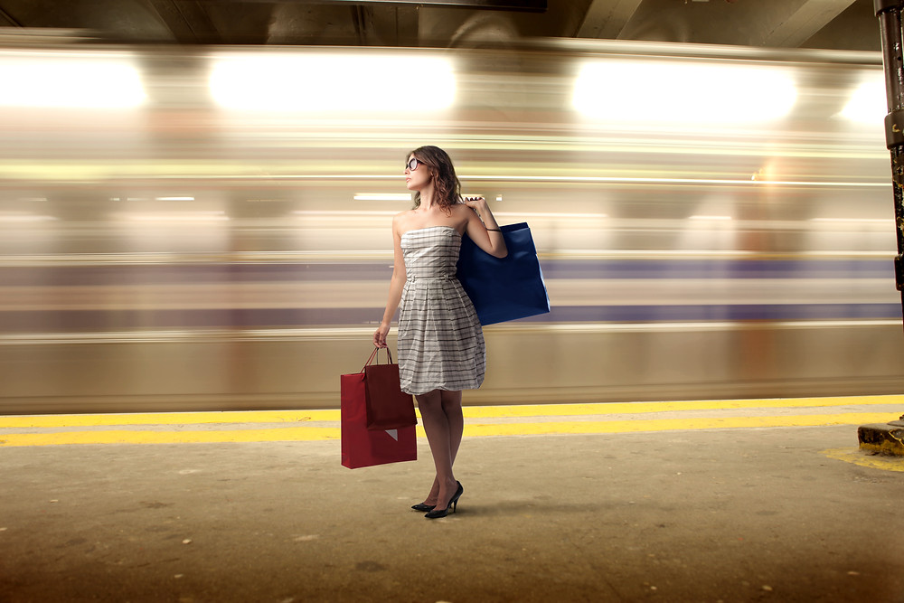 woman waiting for train with luggage