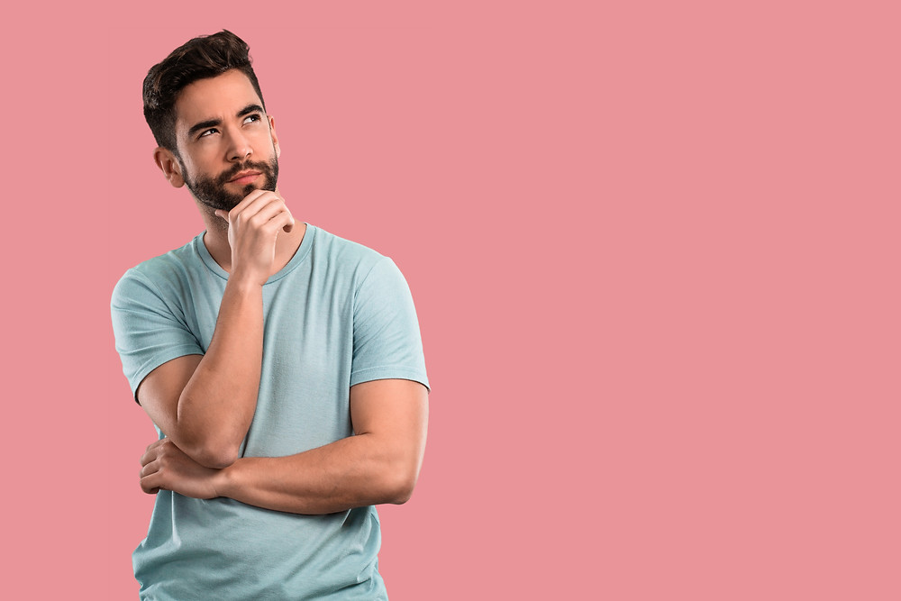 man thinking with pink background