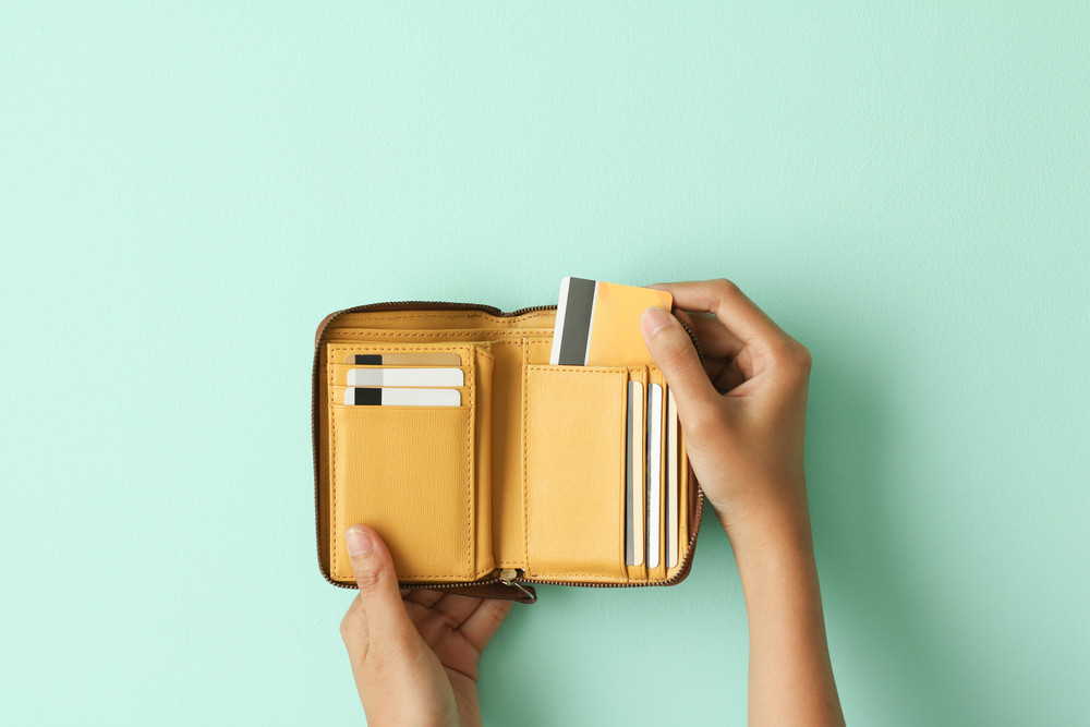 yellow wallet on cyan background