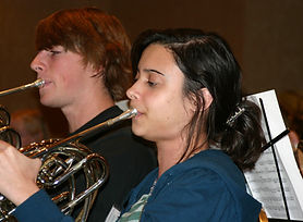 French horn student in honor band