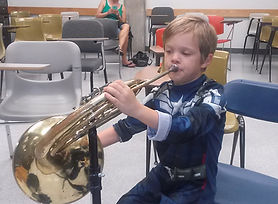 Young French horn student