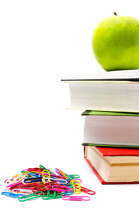 Pile of colorful books and apple on whit