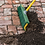 Renegade sweeps up soil off brick patio