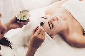 Beautiful woman having a facial cosmetic