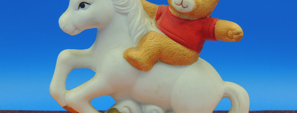 Vintage Bisque Unicorn Figurine Rearing with a teddy bear, Standing on hind legs
