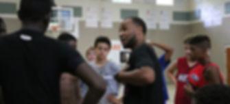 coach bates motivating at 2015 hot hoops camp hanes.jpg
