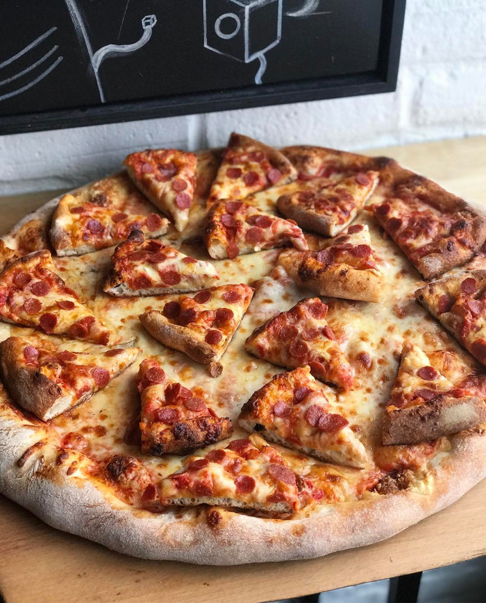 GREATNESS OR MADNESS? THIS SCARBOROUGH BAKERY TOPS IT'S PIZZA WITH MINIATURE SLICES OF PIZZA