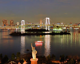 Night view of Rainbow Bridge and Tokyo skyline from Odaiba in Tokyo, Japan