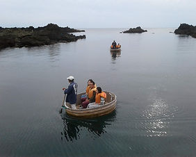 People enjoying a washtub boat ride on Sado Island in Niigata, Japan
