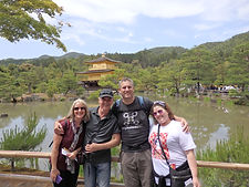 A small grop of people at the Golden Pavilion in Kyoto, Japan