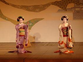 Two geisha dancing in the Furumachi District of Niigata, Japan