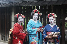 Three geisha in the streets of Gion in Kyoto, Japan