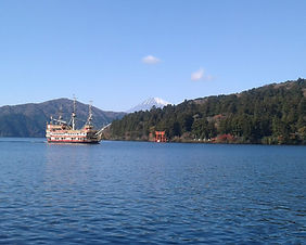 View of Mt. Fuji and Hakone Shrine across Lake Ashi in Hakone, Japan