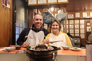 2 people eating lamb in Hokkaido, Japan during our Winter Wonders small group tour of Japan.