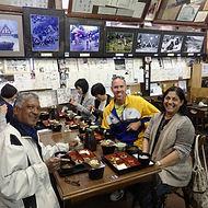 People enjoying a traditional Japanese lunch in Shirakawago, Japan