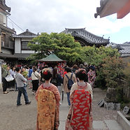 One of our fully escorted private tours of Japan with two geisha at a temple in Kyoto.