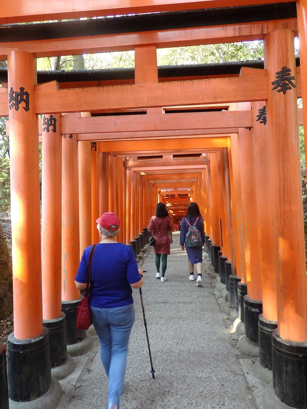 A customer enjoying Fushimi Inari Shrine in Kyoto