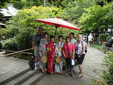 Small tour group mingling with local Japanese at Hasedera Temple in Kamakura, Japan