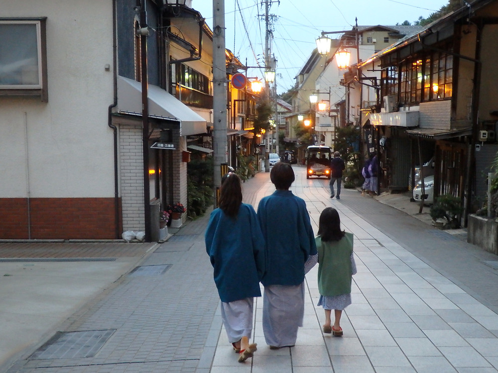 Customers enjoying a stroll through the streets of Shibu Onsen in Nagano