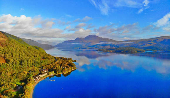 Loch Lomond seen on a luxury private tour with mountains and blue sky