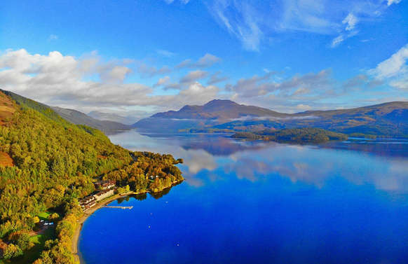 Loch Lomond with blue sky and calm water