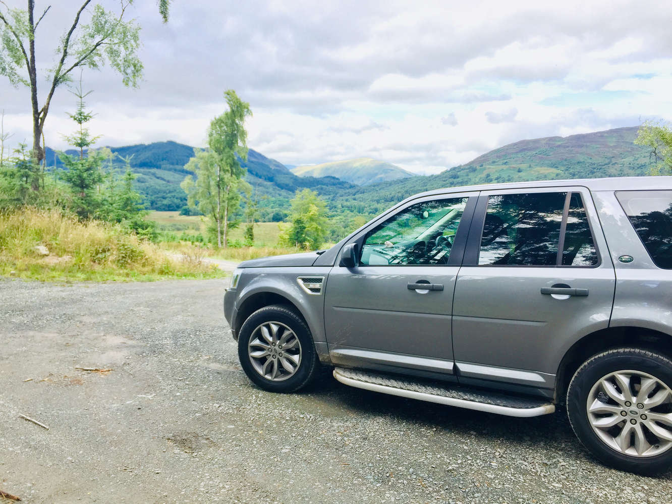 luxury private vehicle off  road during tour in scotland near loch lomond