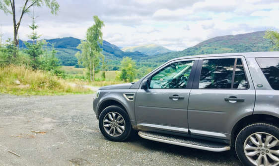 luxury private vehicle off road on a tour of scotland near loch lomond